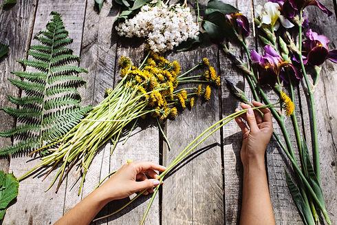 wreath of dandelions flowers and irises
