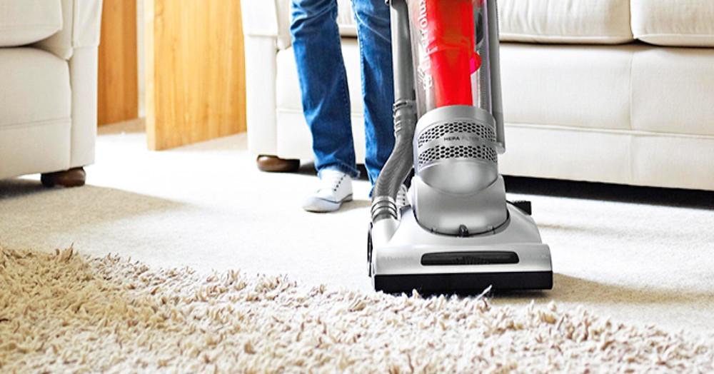Vacuuming carpet.