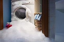 Overflowing washing machine.