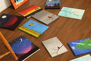 paintings laying on the floor