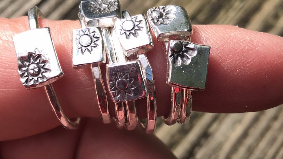 Stacking ring with stamped flower