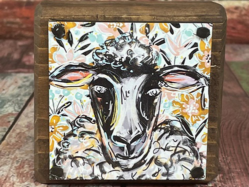 Sit Around -  Sheep with floral background