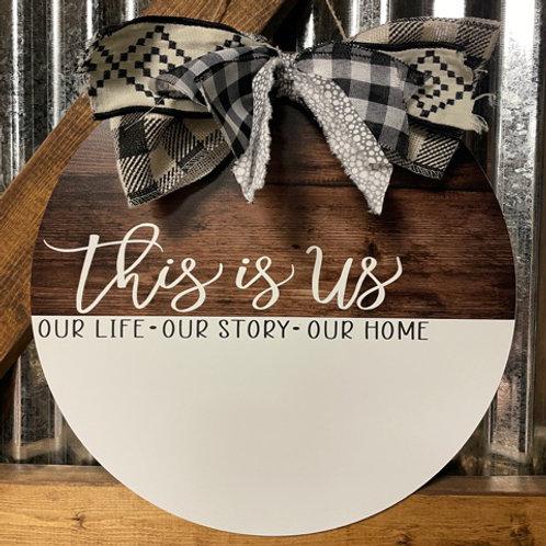 This Is Us white lettering wood grain doorhanger