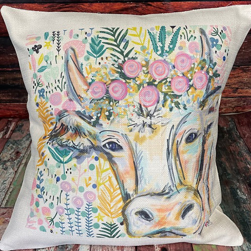 Cow with floral pillow