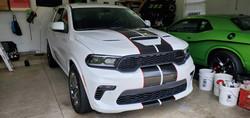 Black Metallic Racing Stripes with Red Reflective Pinstripe - Installed on a White Dodge Durango