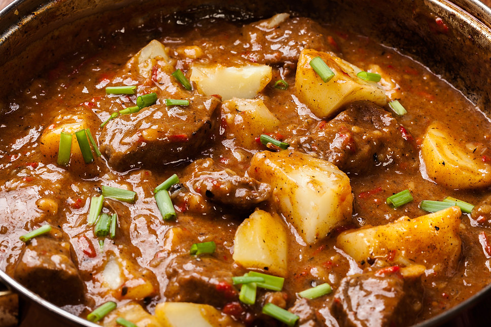 Beef stew with potatoes in a pan.jpg