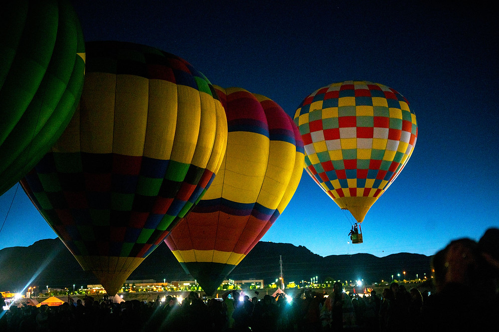 Balloons taking off as sun comes up
