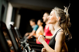 young-people-running-treadmills-modern-g