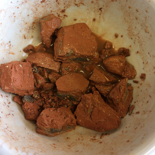 Soil and clay being crushed