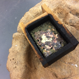 copper poured into wooden mould