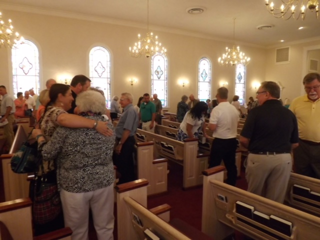 church congregation greeting.JPG
