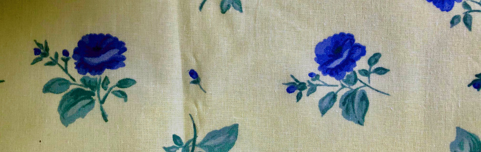 Blue flowers on pale yellow