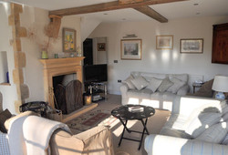 Main sitting room with open fire