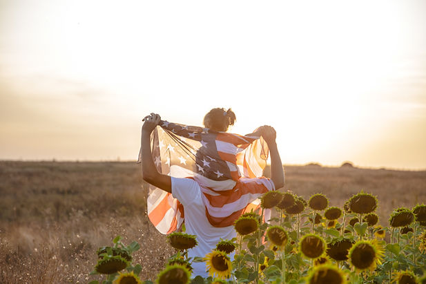 happy-family-with-american-flag-sunset.j