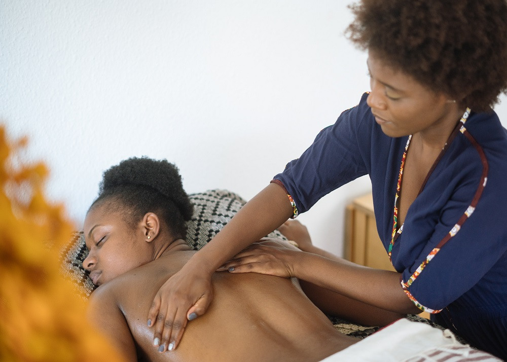 African-American Woman Getting a Massage by African-American Massage Therapist