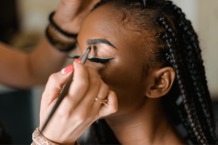 Applying Makeup on An African American Woman
