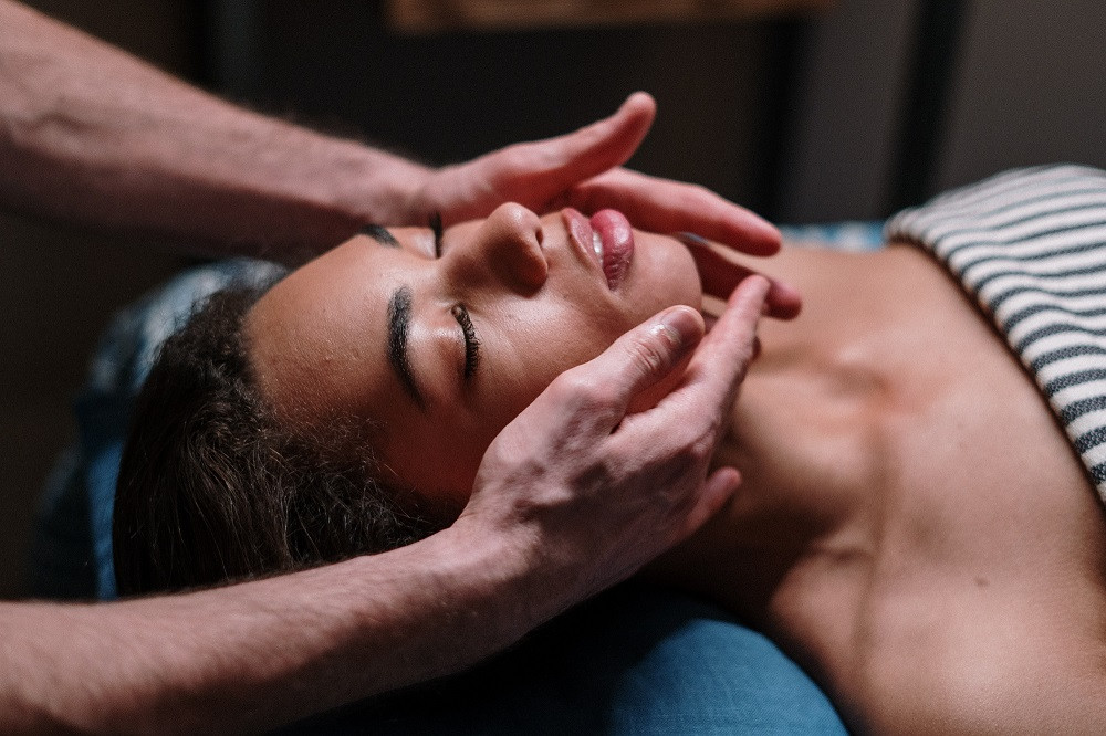 African-American Woman on Massage Table Getting Facial
