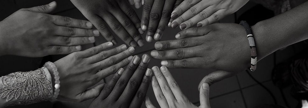Hands of happy group of African people w