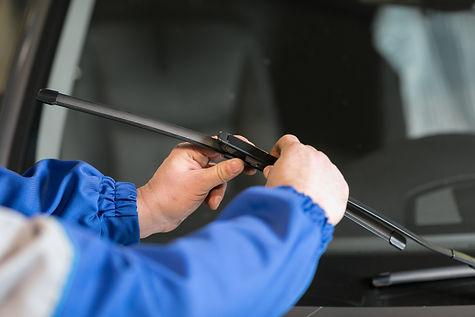 Technician is changing windscreen wipers