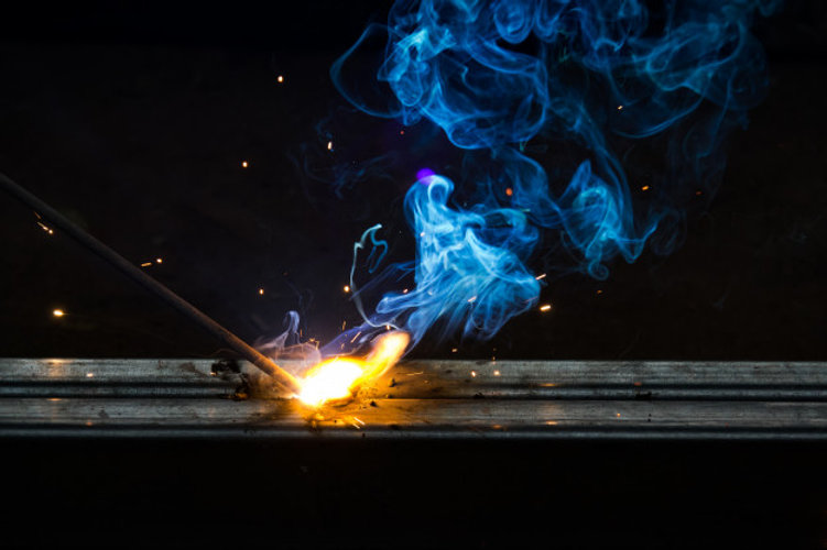 smoke-flame-welding-work-dark-background