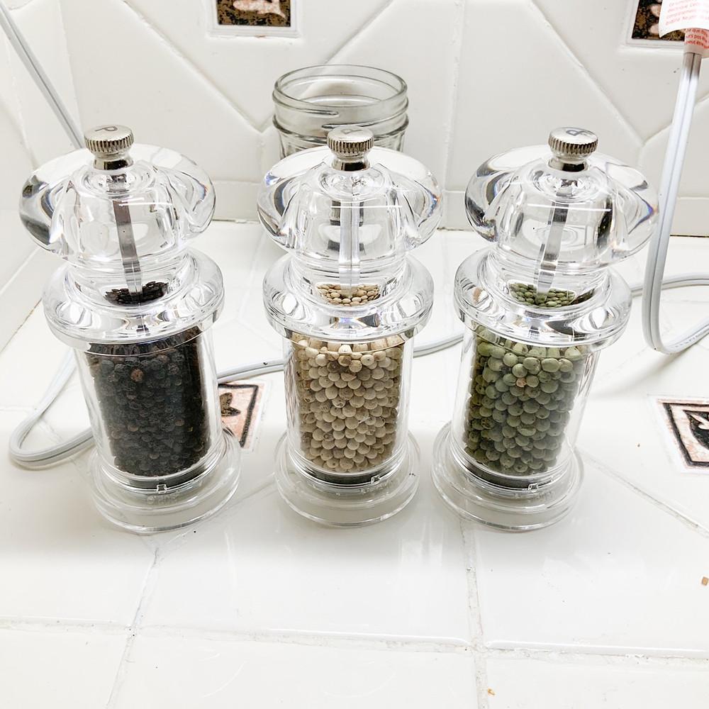 three pepper mills
