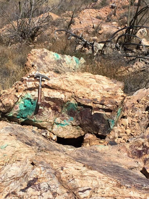 Copper staining and rock hammer