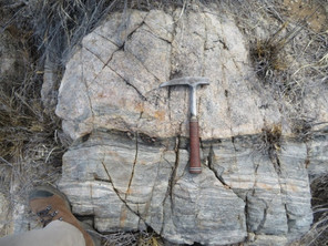 Rock Hammer on banded sediment and intrusive contact