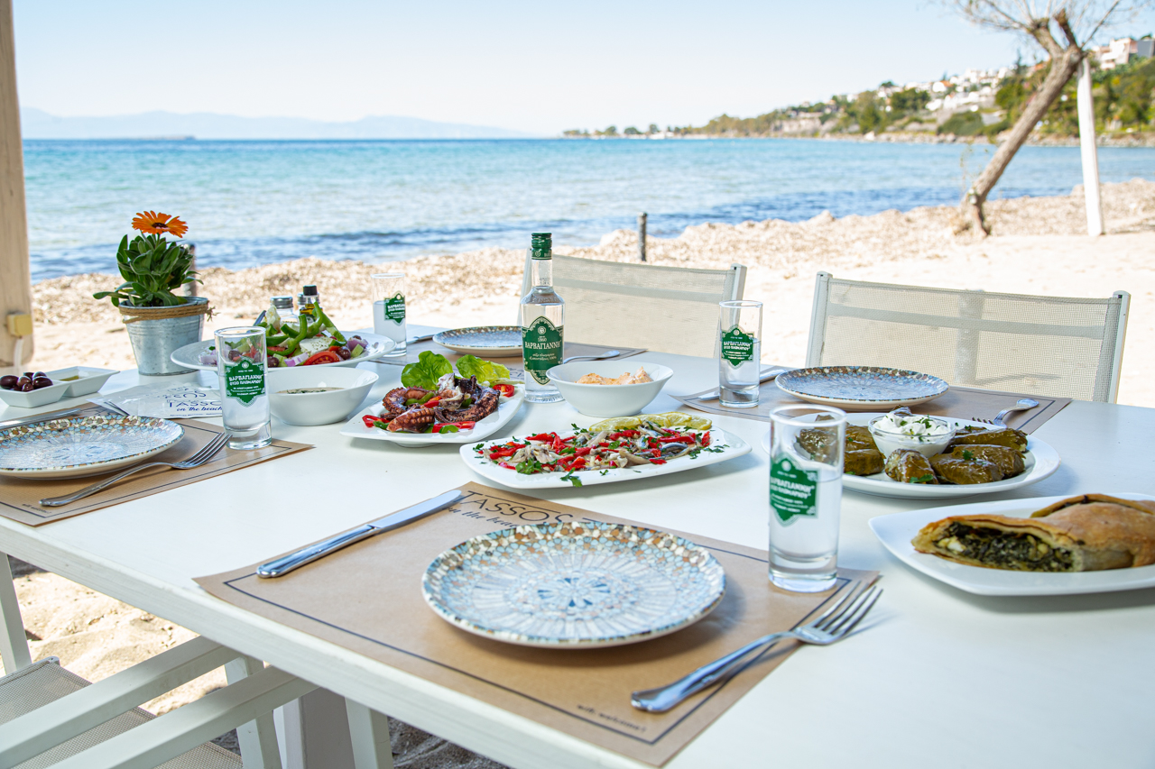 Ouzo and meze plates by the sea