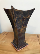 Slab-built reaching vase