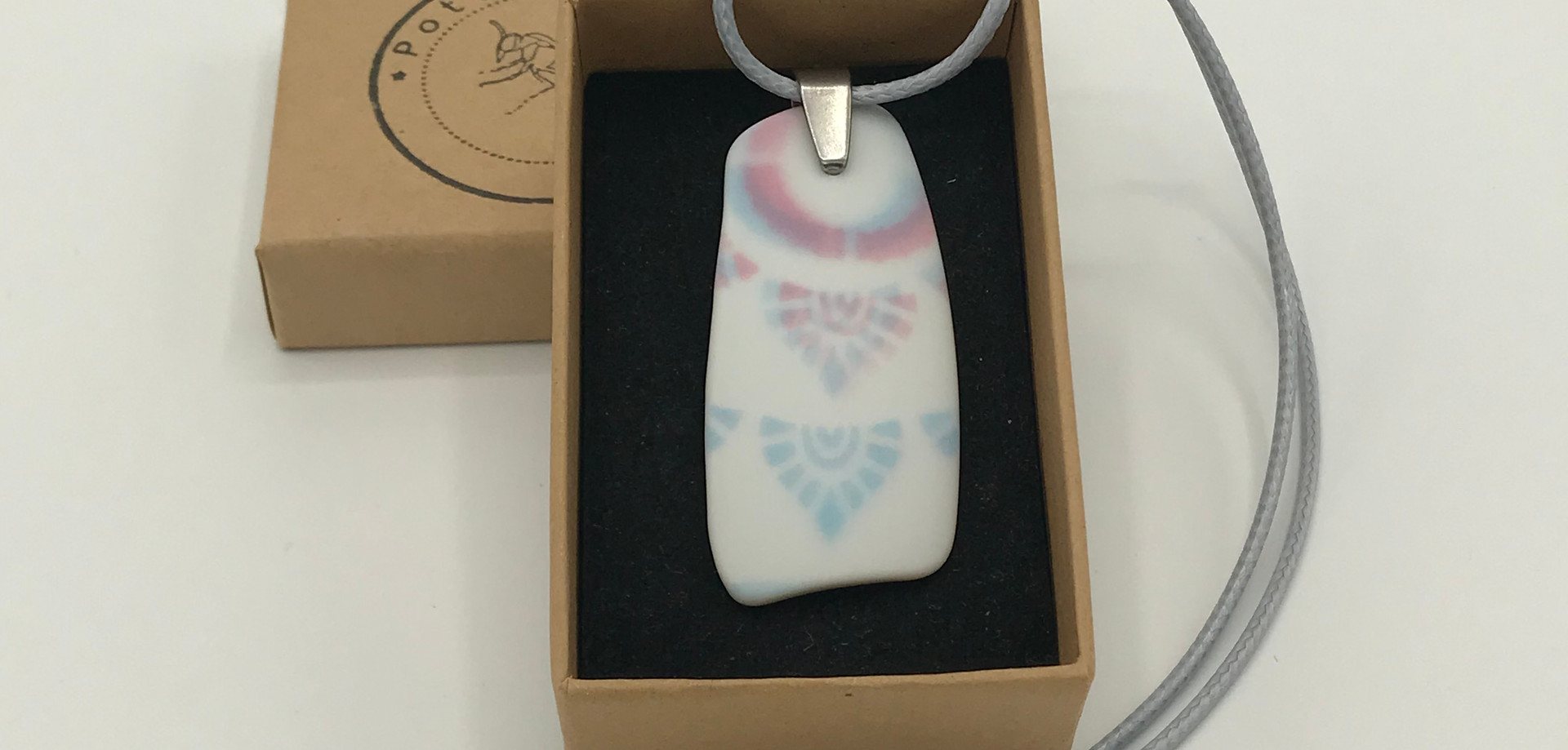 Recycled ceramic shard pendant decorated with tattoo inks and acrylic varnish