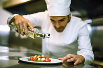 Chef Pouring Vinegar onto Food