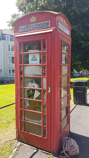 A picture of a Phonebox with a sign saying The Little Library from the first lockdown 2020