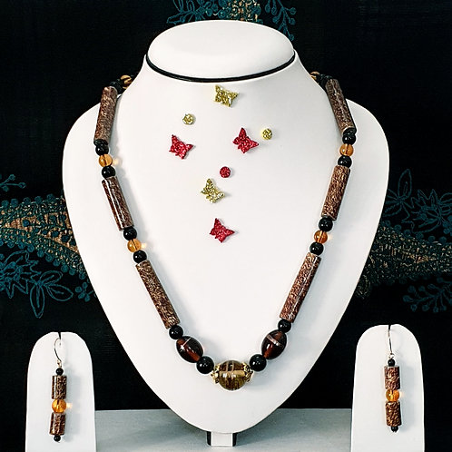 Neck piece set of brown roller beads with matching ear rings