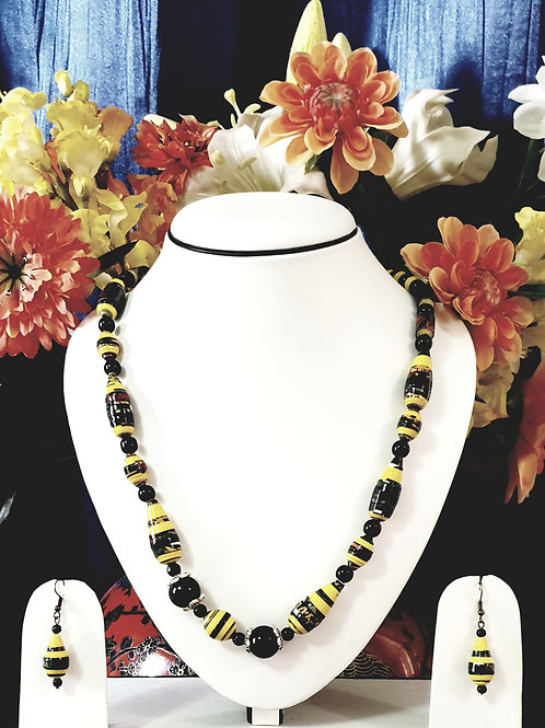 Neck piece set of black and yellow beads with matching ear rings