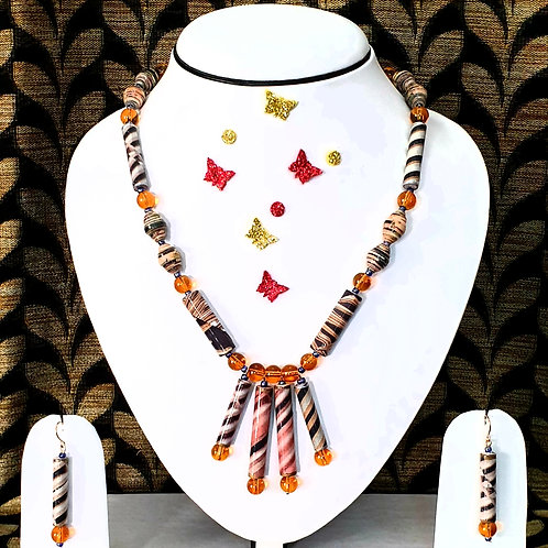 Neck piece set of multi colour roller beads with matching ear rings