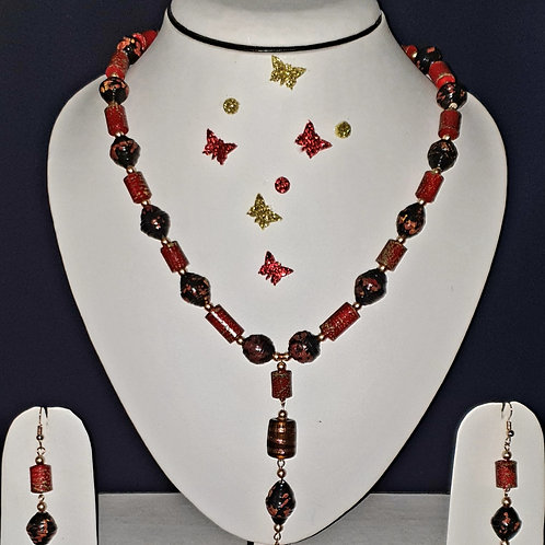 Neck piece set of red round and roller beeds  with matching ear rings