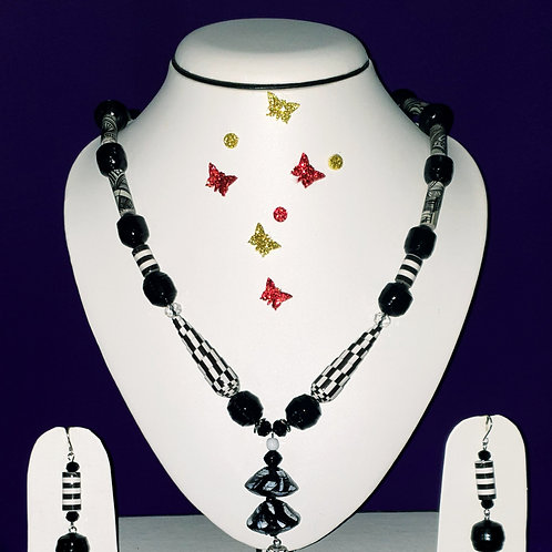 Neck piece set of black and white beads  with matching ear rings