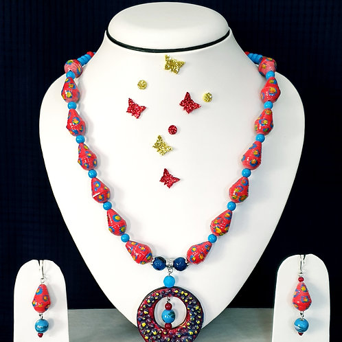 Neck piece set of red beads and disc pendent with matching ear rings