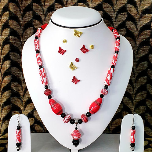 Neck piece set of red  beads and black spacers with matching ear rings
