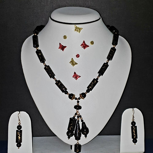 Neck piece set of black roller beads and  pendant with matching ear rings