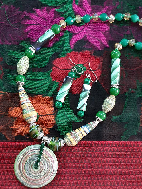 Neck piece set of light shade beads and disc pendent with matching ear rings