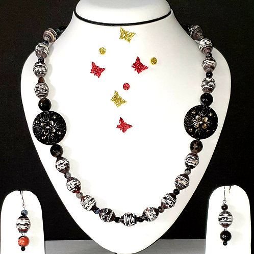 Neck piece set of black and grey beads with matching ear rings