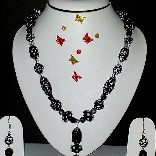 Neck piece set of black beeds and pendant with matching ear rings