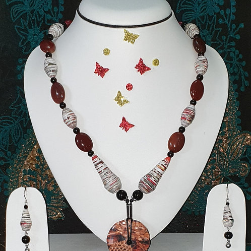 Neck piece set of red and white beads with disk pendant and matching ear rings