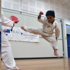 Isaiah Jump Rev Turning Kick 1.jpg