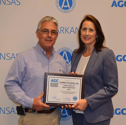 Kevi and Lisa Coakley Accepting an Award