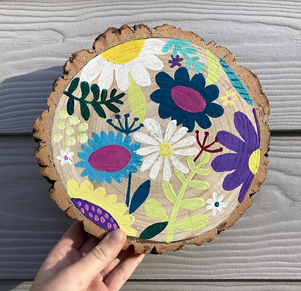 Hand painted flowers on a oak circle,  donations to Mind Charity