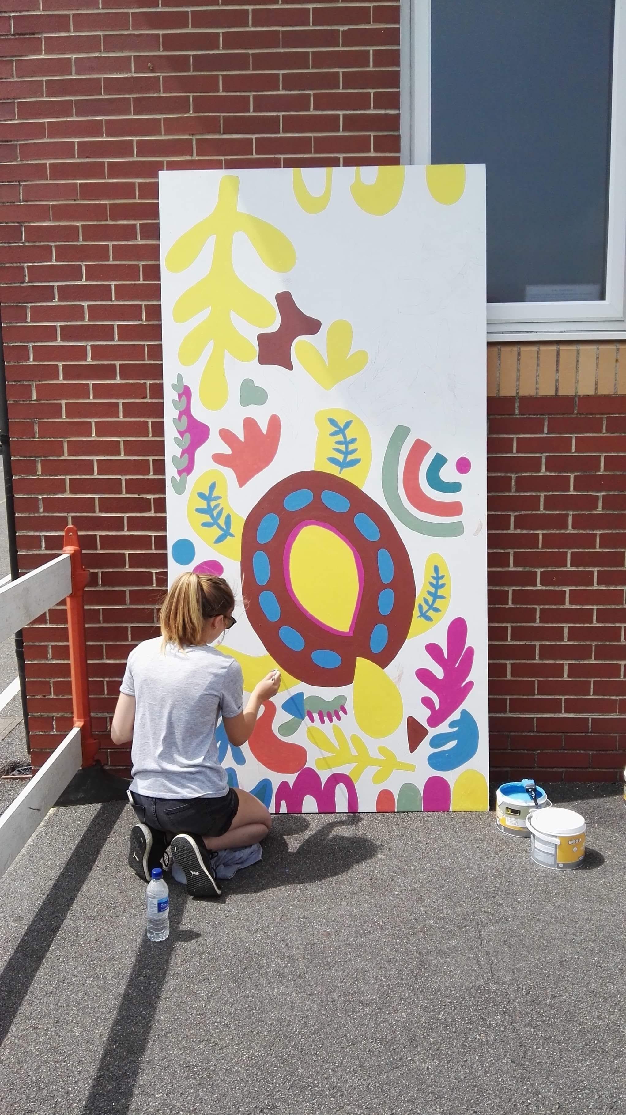 Painting school mural