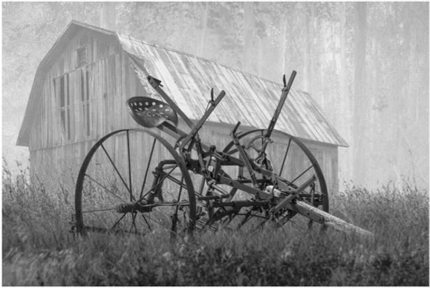 old-rusted-farm-equipment-in-the-morning