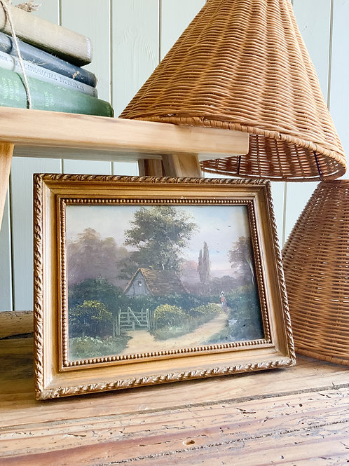 Landscape painting in its original wooden frame